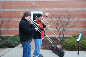 Kevin Downing (right) gives a trombone lesson